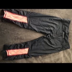 UA Heat Gear capris with mesh accents